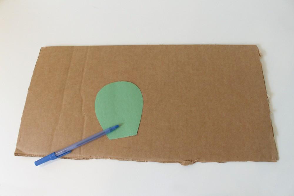 green paint on cardboard