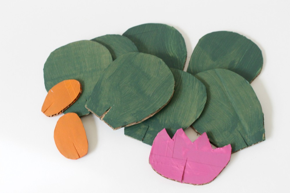 small cut out cardboard pieces painted to resemble cacti