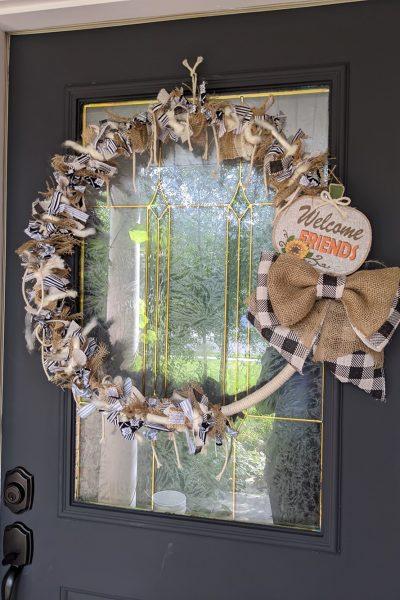 farmhouse rustic rag wreath on a dark gray front door