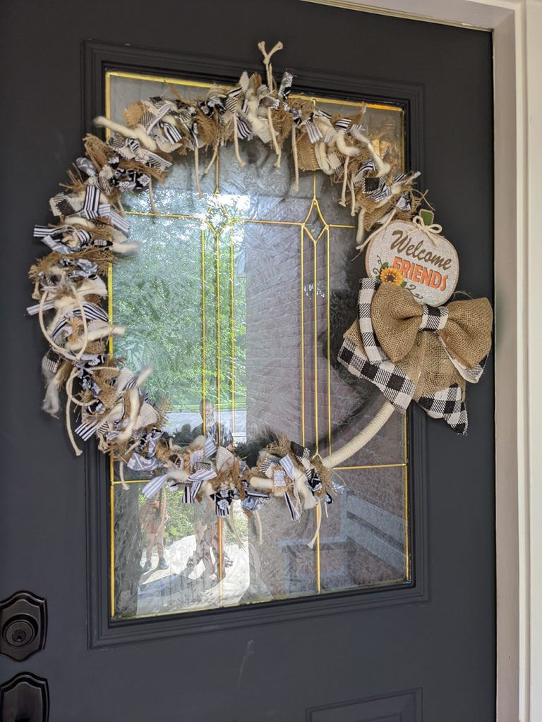 farmhouse rustic rag wreath on a dark gray front door