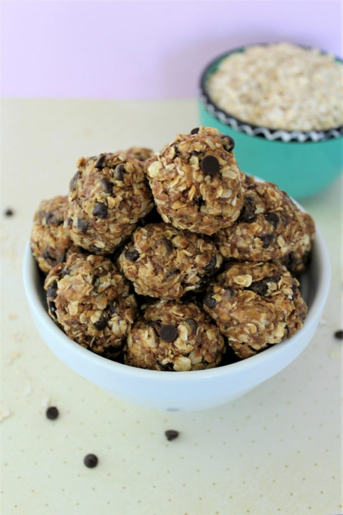 small bite sized balls of oatmeal based treats in a bowl