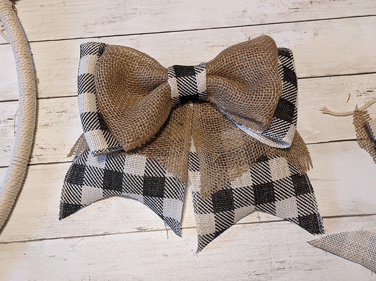 a large burlap and buffalo check bow