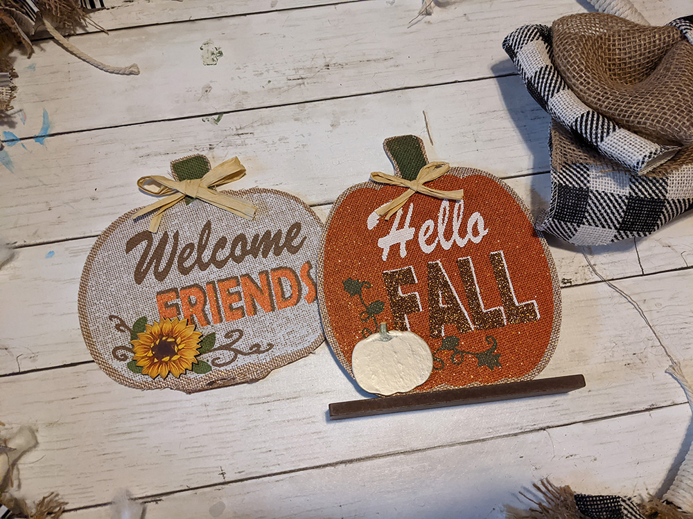 two small dollar tree pumpkin signs