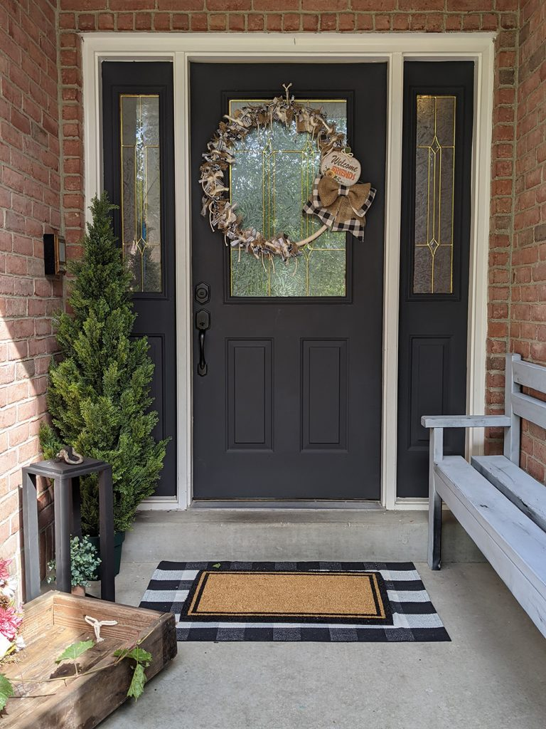 a beautifully decorated front porch