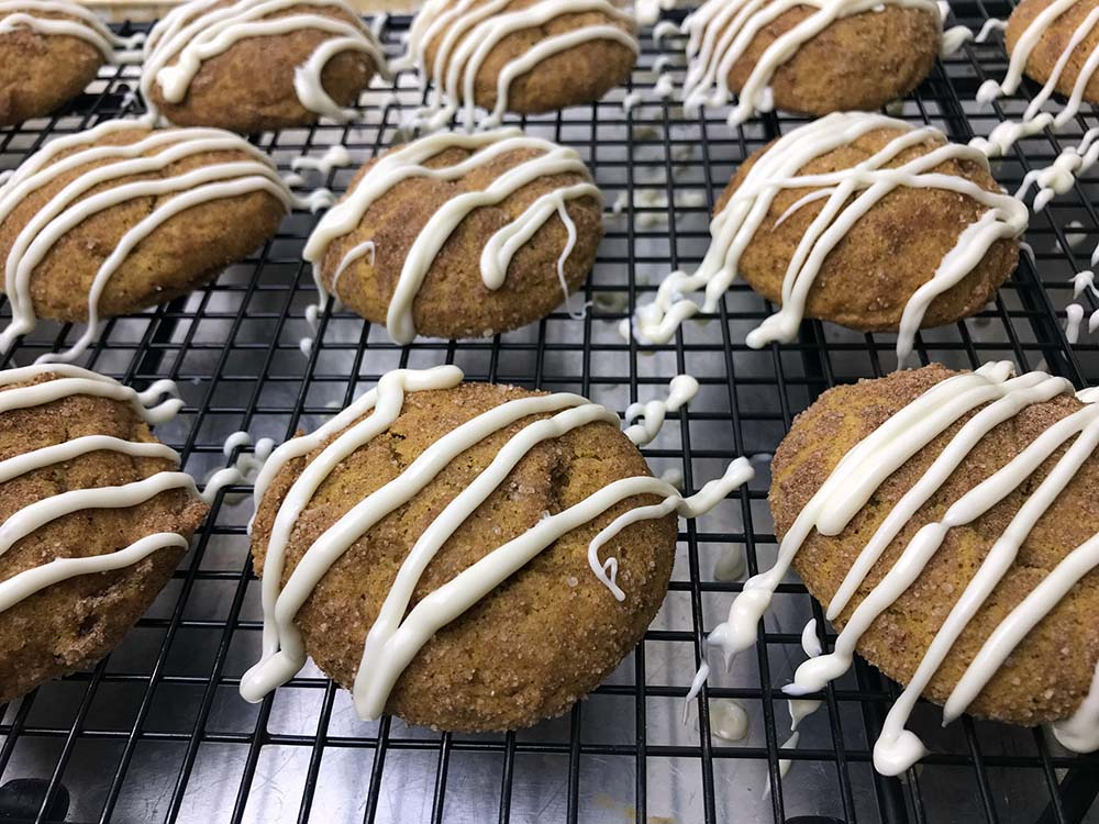 pumpkin spice cookies on a cooling tray